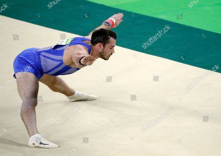 Britain's Kristian Thomas performs on the floor during the artistic gymnastics men's apparatus final