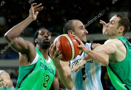 Argentina's Manu Ginobili (5) passes between Brazil's Nene Hilario, left, and Marcelinho Huertas, right, during a basketball game at the 2016 Summer Olympics in Rio de Janeiro, Brazil, . Argentina won 111-107 in double overtime
