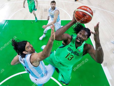 Brazil's Nene Hilario (13) shoots over Argentina's Luis Scola, left, during a basketball game at the 2016 Summer Olympics in Rio de Janeiro, Brazil