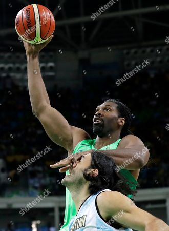 Brazil's Nene Hilario, top, drives to the basket over Argentina's Luis Scola during a basketball game at the 2016 Summer Olympics in Rio de Janeiro, Brazil