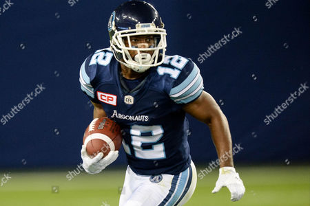 Stock Photo of Toronto Argonauts wide receiver Larry Taylor (12) runs with the ball