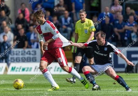 Rangers Niko Kranjcar gets his jersey pulled by Dundee's Paul McGowan during the SPFL Premiership match between Dundee and Rangers at Dens Park, Dundee on 13th August