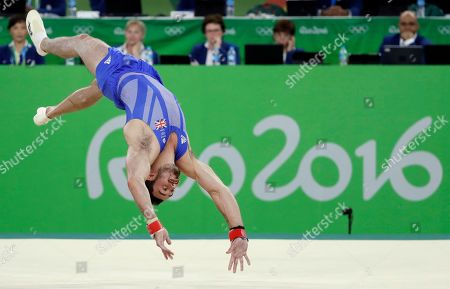 Stock Photo of Britain's Kristian Thomas performs on the floor during the artistic gymnastics men's apparatus final