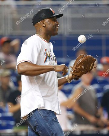 Cliff Floyd Former Florida Marlins' Cliff Floyd celebrates after catching a ceremonial first pitch thrown out by his son Tobias before the start of a baseball game between the Miami Marlins and the Chicago White Sox, in Miami
