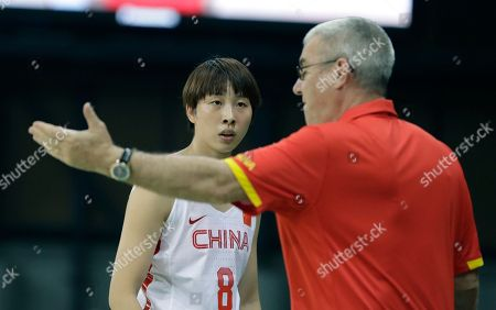 China head coach Tom Maher talks with guard Di Wu during the first half of a women's basketball game against the United States at the Youth Center at the 2016 Summer Olympics in Rio de Janeiro, Brazil