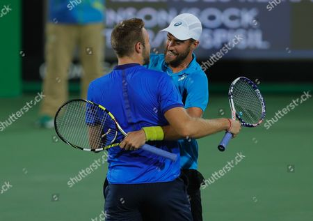 Jack Sock, left, and Steve Johnson of the United States celebrate defeating Canada's Vasek Pospisil and Daniel Nestor in the men's doubles tennis competition at the 2016 Summer Olympics in Rio de Janeiro, Brazil