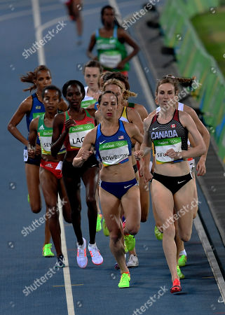 Canada's Nicole Sifuentes, right, and United States' Shannon Rowbury, center, competes in a women's 1500-meter heat during the athletics competitions of the 2016 Summer Olympics at the Olympic stadium in Rio de Janeiro, Brazil