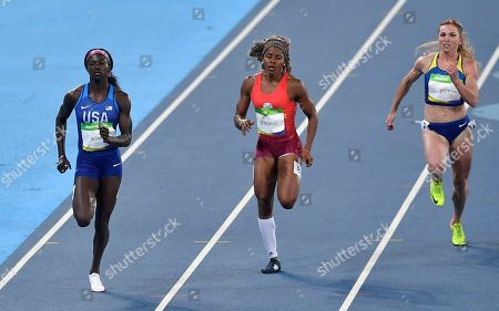 Stock Photo of United States' Tori Bowie, left, Ecuador's Angela Tenorio, center, and Ukraine's Khrystyna Stuy compete in a women's 100-meter heat during the athletics competitions of the 2016 Summer Olympics at the Olympic stadium in Rio de Janeiro, Brazil
