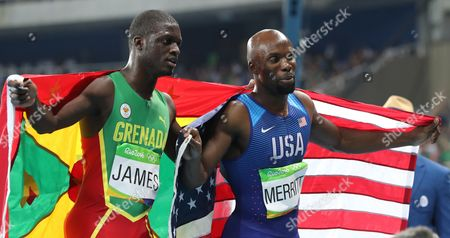 United States' Lashawn Merritt, right, and Grenada's Kirani James celebrate after winning bronze and silver respectively during the athletics competitions of the 2016 Summer Olympics at the Olympic stadium in Rio de Janeiro, Brazil