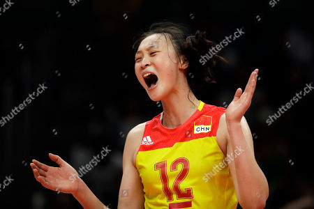 China's Hui Ruoqi celebrates during a women's preliminary volleyball match against the United States