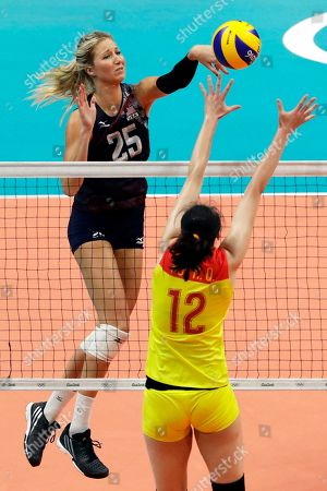 United States' Karsta Lowe (25) spikes the ball as China's Hui Ruoqi defends during a women's preliminary volleyball match