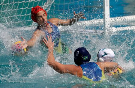 Tess Oliveira, Rowie Webster Brazil's goalkeeper Tess Oliveira failed to stop a shot by Australia's Rowie Webster, right, during women's water polo preliminary round match at the 2016 Summer Olympics in Rio de Janeiro, Brazil
