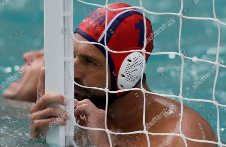 Merrill Moses United States' goalkeeper Merrill Moses reacts after failing to stop a goal during their men's water polo preliminary round match against Montenegro at the 2016 Summer Olympics in Rio de Janeiro, Brazil