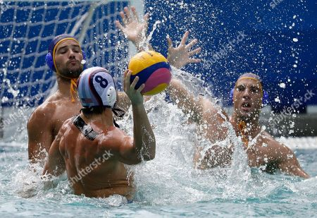 United States' Tony Azevedo passes the ball forward as Montenegro's Aleksandar Ivovic, right, and Montenegro's Mladan Janovic go to block during their men's water polo preliminary round match at the 2016 Summer Olympics in Rio de Janeiro, Brazil