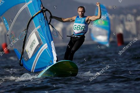 Britain's windsurfer Nick Dempsey celebrates winning silver in the RS: X men's event at the Summer Olympics in Rio de Janeiro, Brazil