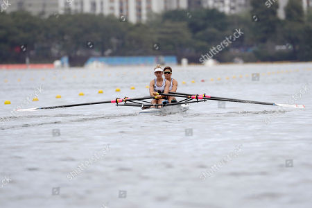 Charlotte Taylor and Katherine Copeland, of Britain, compete in the women's rowing lightweight double sculls final during the 2016 Summer Olympics in Rio de Janeiro, Brazil