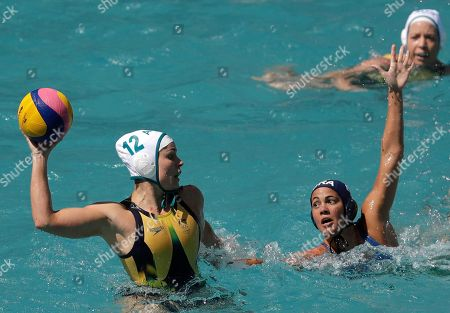 Australia's Nicola Zagame, left, shoots against Brazil's Marina Canetti, right, during their women's water polo preliminary round match at the 2016 Summer Olympics in Rio de Janeiro, Brazil