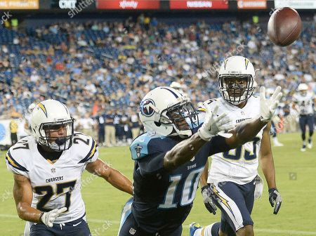 San Diego Chargers defensive back Richard Crawford (35) and San Diego Chargers running back Kenneth Farrow (27)defend Tennessee Titans wide receiver Tre McBride (10) on a pass attempt during the second half of an NFL preseason football game, in Nashville, Tenn