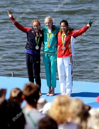 Gold medalist Kimberley Brennan, of Australia, center, silver medalist Genevra Stone, of United States, left, and bronze medalist Duan Jingli,of China, celebrate with their medals after the women's rowing single sculls final during the 2016 Summer Olympics in Rio de Janeiro, Brazil