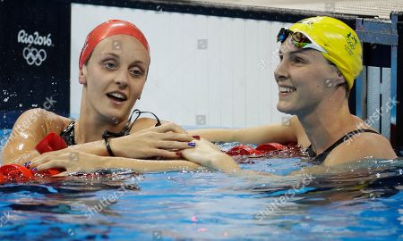 Britain's Francesca Halsall and Australia's Bronte Campbell, right, look at the clock at the end of the women's 50-meter freestyle semifinal during the swimming competitions at the 2016 Summer Olympics, in Rio de Janeiro, Brazil