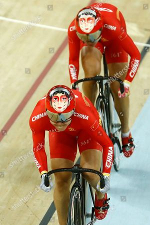 Tianshi Zhong of China, front, and teammate Jinjie Gong compete in the Women's team sprint qualifying