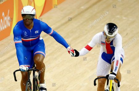 Gregory Bauge, left, of France, and Pavel Kelemen of the Czech Republic embrace after racing in a men's sprint heat inside the Rio Olympic Velodrome