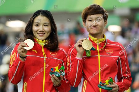 Zhong Tianshi, Gong Jinjie Gong Jinjie, left, and Zhong Tianshi, right, of China hold their gold medals on the podium of the Women's team sprint finals at the Rio Olympic Velodrome during the 2016 Summer Olympics in Rio de Janeiro, Brazil