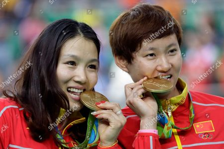 Tianshi Zhong, Jinjie Gong Jinjie Gong, left, and teammate Tianshi Zhong, right, of China pose with their gold medals in the podium of the Women's team sprint finals at the Rio Olympic Velodrome during the 2016 Summer Olympics in Rio de Janeiro, Brazil