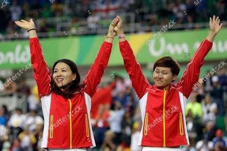 Tianshi Zhong, Jinjie Gong Gold medalists Gong Jinjie, left, and Zhong Tianshi, right, of China wave from the podium of the Women's team sprint finals at the Rio Olympic Velodrome during the 2016 Summer Olympics in Rio de Janeiro, Brazil