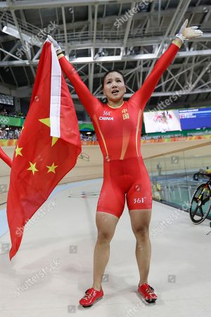 Jinjie Gong of China celebrates after winning gold in the Women's team sprint finals at the Rio Olympic Velodrome during the 2016 Summer Olympics in Rio de Janeiro, Brazil