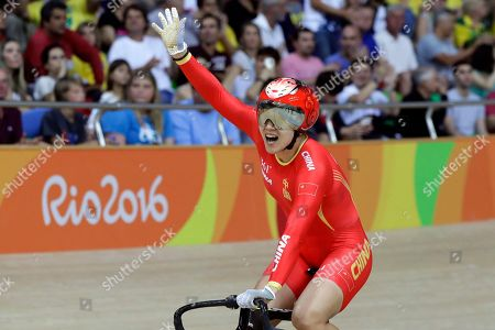 Tianshi Zhong Jinjie Gong of China celebrates after winning gold with teammate Tianshi Zhong in the Women's team sprint finals at the Rio Olympic Velodrome during the 2016 Summer Olympics in Rio de Janeiro, Brazil