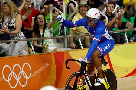 Gregory Bauge of France celebrates after competing in the Men's Sprint 1/8 finals at the Rio Olympic Velodrome during the 2016 Summer Olympics in Rio de Janeiro, Brazil