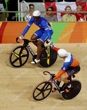Gregory Bauge of France, top, and Jeffrey Hoogland of the Netherlands embrace after competing in the Men's Sprint 1/8 finals at the Rio Olympic Velodrome during the 2016 Summer Olympics in Rio de Janeiro, Brazil