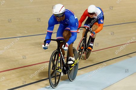 Gregory Bauge of France, left, and Jeffrey Hoogland of the Netherlands compete in the Men's Sprint 1/8 finals at the Rio Olympic Velodrome during the 2016 Summer Olympics in Rio de Janeiro, Brazil