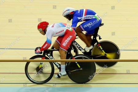 Denis Dimitriev of Russia, left, and Gregory Bauge of France compete in the men's sprint quarterfinals cycling event at the Rio Olympic Velodrome during the 2016 Summer Olympics in Rio de Janeiro, Brazil