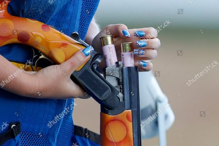 Amber Hill of Britain adds cartridges after shooting during the women's skeet semifinals