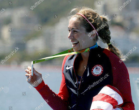 Genevra Stone, of United States, smiles after receiving her silver medal in the women's single sculls during the 2016 Summer Olympics in Rio de Janeiro, Brazil