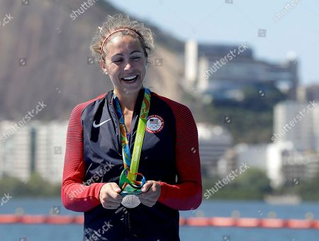 Stock Image of Genevra Stone, of United States, smiles after receiving her silver medal in the women's single sculls during the 2016 Summer Olympics in Rio de Janeiro, Brazil