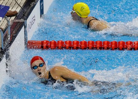 Britain's Francesca Halsall, touches ahead of Australia's Bronte Campbell, top, in their women's 50-meters freestyle semifinal during the swimming competitions at the 2016 Summer Olympics, in Rio de Janeiro, Brazil