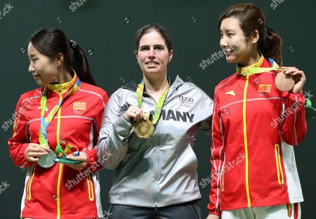Stock Image of Barbara Engleder, Zhang Binbin, Du Li Gold medalist Barbara Engleder, center, of Germany is flanked by silver medalist Zhang Binbin, left, of China and bronze medalist Du Li, right, of China during the award ceremony for the women's 50 meter rifle 3 positions event at Olympic Shooting Center at the 2016 Summer Olympics in Rio de Janeiro, Brazil