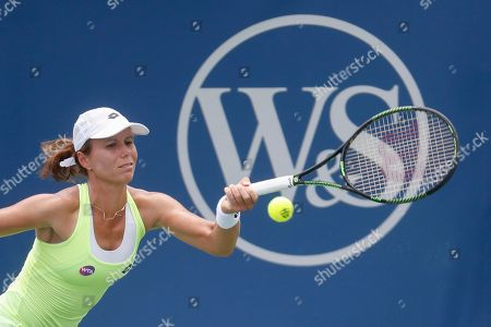 Stock Image of Vavara Lepchenko Varvara Lepchenko, of the United States, returns the ball to Donna Vekic, Croatia, during the qualifying round at the Western & Southern Open tennis tournament, in Mason, Ohio