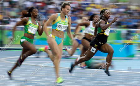 Jamaica's Veronica Campbell-Brown, right, and Kazakhstan's Olga Safronova compete in a women's 200-meter heat during the athletics competitions of the 2016 Summer Olympics at the Olympic stadium in Rio de Janeiro, Brazil