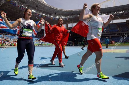Britain's bronze medal winner Sophie Hitchon, China's silver medal winner Zhang Wenxiu and Poland's gold medal winner Anita Wlodarczyk, from left, celebrate after the women's hammer throw final at the athletics competitions of the 2016 Summer Olympics at the Olympic stadium in Rio de Janeiro, Brazil