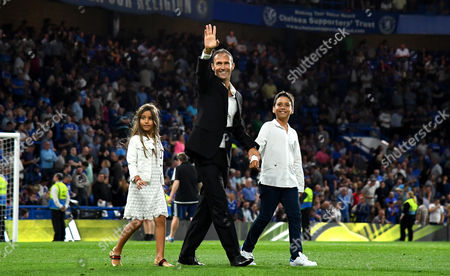 Former Chelsea player Ricardo Carvalho waves to the fans as he walks on the pitch at half time during the Premier League match between Chelsea and West Ham United played at Stamford Bridge, London on 15th August 2016