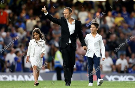 Former Chelsea defender Ricardo Carvalho does a lap of the Stamford Bridge pitch at half time