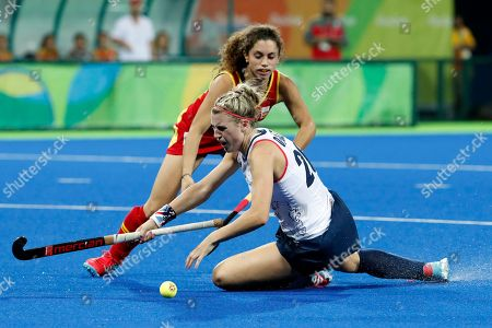 Stock Picture of Britain's Lily Owsley, front, fights for the ball with Spain's Georgina Oliva during a women's field hockey quarter final match at the 2016 Summer Olympics in Rio de Janeiro, Brazil