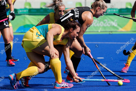 Stock Photo of New Zealand's Stacey Michelsen, right, fights for the ball with Australia's Georgie Parker during a women's field hockey quarter final match at the 2016 Summer Olympics in Rio de Janeiro, Brazil
