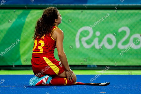 Stock Photo of Spain's Georgina Oliva kneels on the pitch after her team lost to Great Britain during a women's field hockey quarter final match