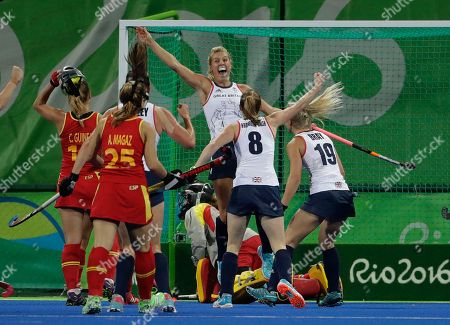 Great Britain's Georgie Twigg, center background, celebrates after she scored against Spain during a women's field hockey quarterfinal match at 2016 Summer Olympics in Rio de Janeiro, Brazil