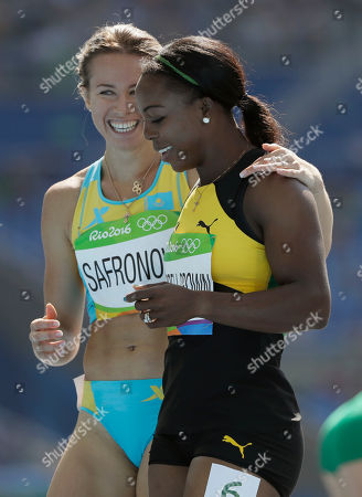 Third placed Jamaica's Veronica Campbell-Brown, right, and fourth placed Kazakhstan's Olga Safronova after competing in a women's 200-meter heat during the athletics competitions of the 2016 Summer Olympics at the Olympic stadium in Rio de Janeiro, Brazil